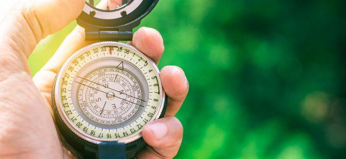 Man navigating with compass